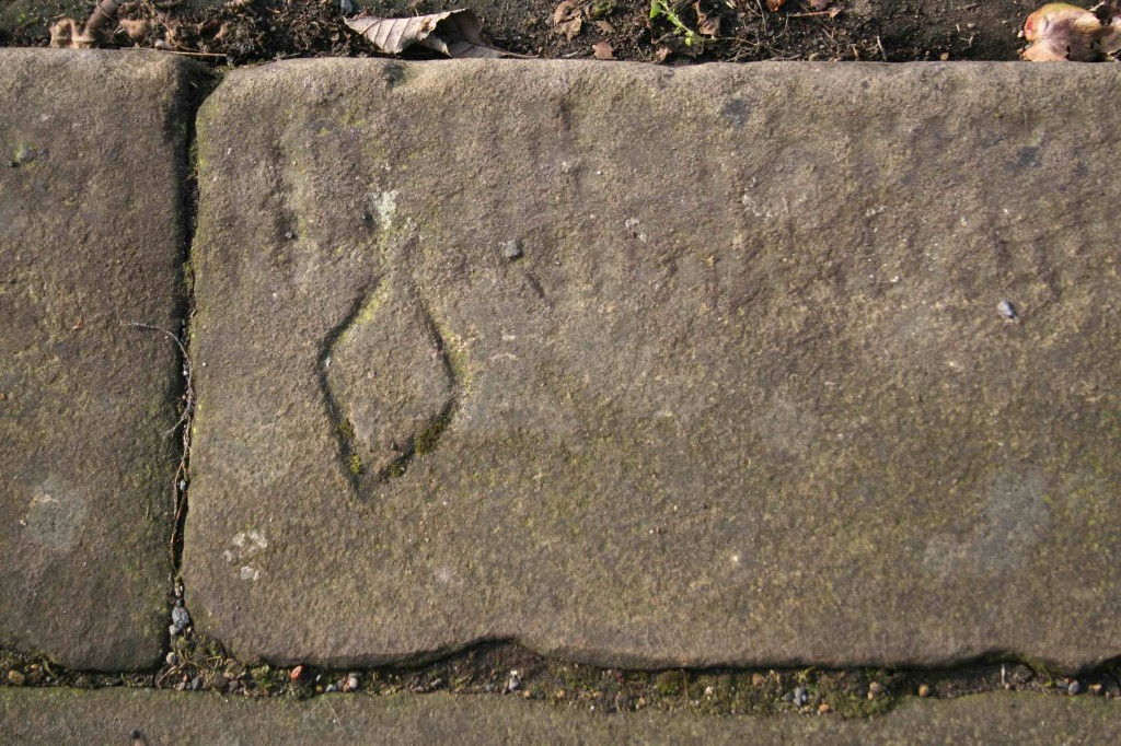 Alice Fox Saltaire kerbstone masons mark diamond