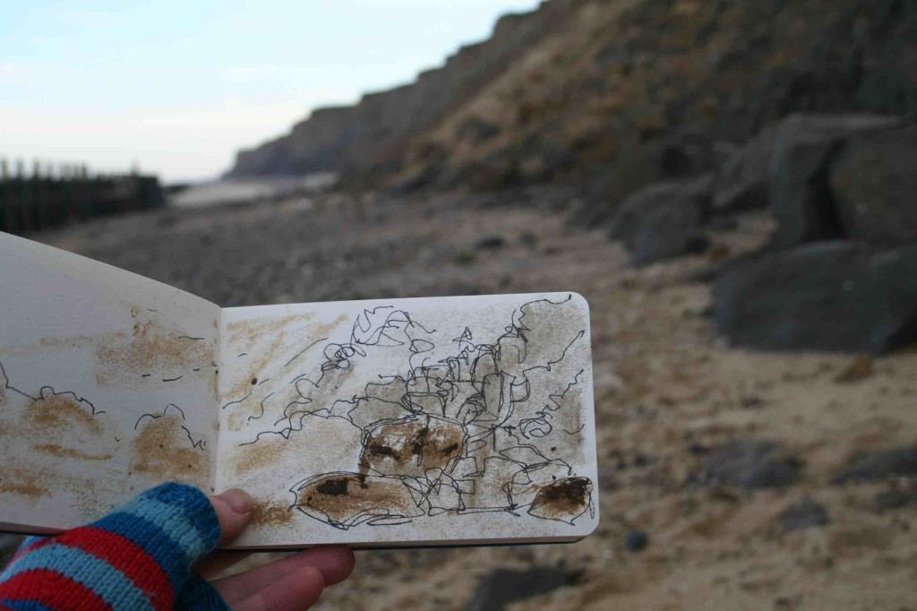 Alice Fox drawing with cliff-fallen clay